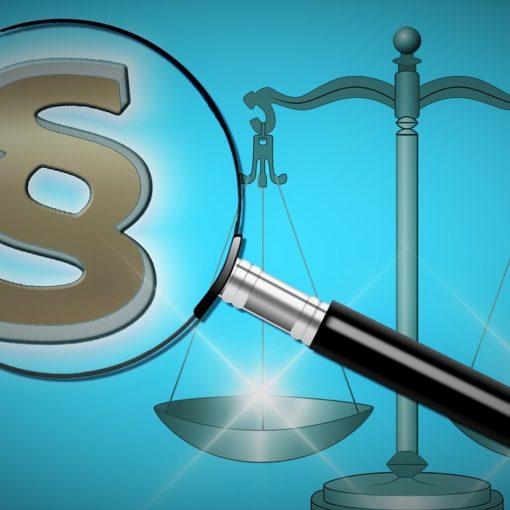 paragraf i waga symbolizująca sprawiedliwość